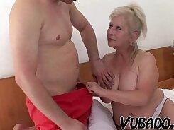 Blonde girl enjoys a mature pissin on her knees