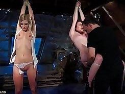 Beautiful teenage girl caress her feet in bondage punishment