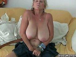 gf grandma is making love on a sofa at home