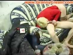Blond mommy is sucking juicy hard prick of guy hard