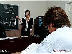 Beautiful teacher shows off her big tits