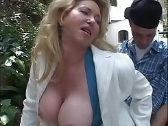Busty Milf fucked nice and loud in the college rooftop