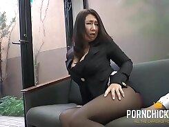Badass tanned secretary in stockings sucks two cocks