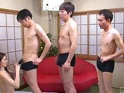 Bonny Japanese girl performs great double blowjob on the floor